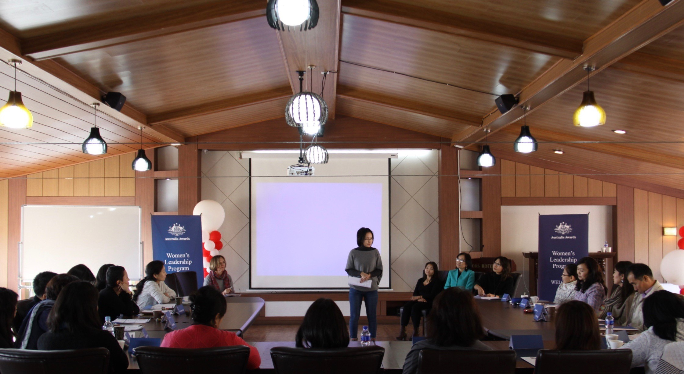 Attendees of the three day Women's Leadership Program (WLP) Orientation Retreat attend a presentation.
