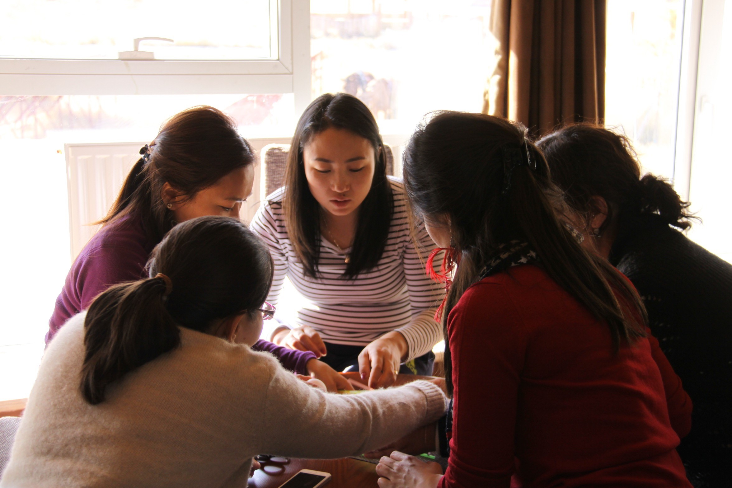 Attendees of the three day Women's Leadership Program (WLP) Orientation Retreat participate in team building activities.